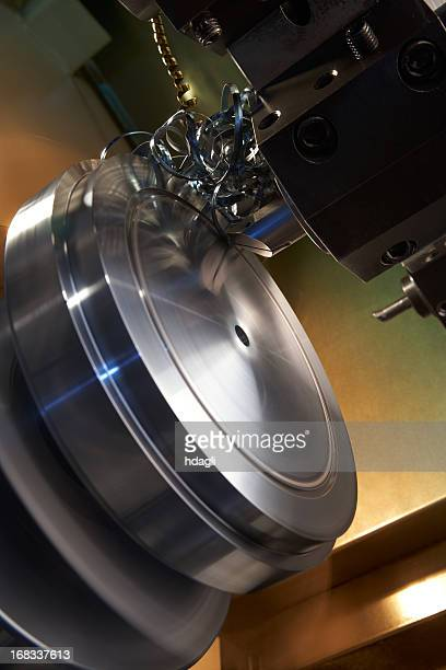 CNC machine making circular grooves and steel filings