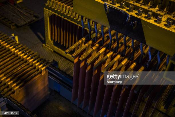 A machine moves copper anodes and cathodes during the electrolytic refining process at the Southern Copper Corp refinery in Ilo Peru on Thursday Jan...