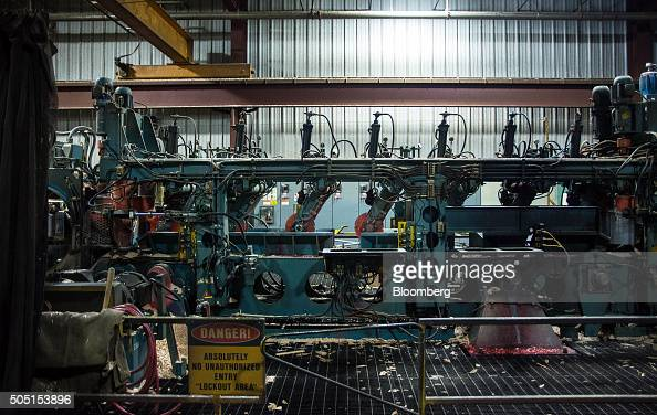 A machine moves lumber through the mill at the Resolute Forest Products facility in Thunder Bay Canada Ontario on Friday Jan 8 2016 Resolute Forest...