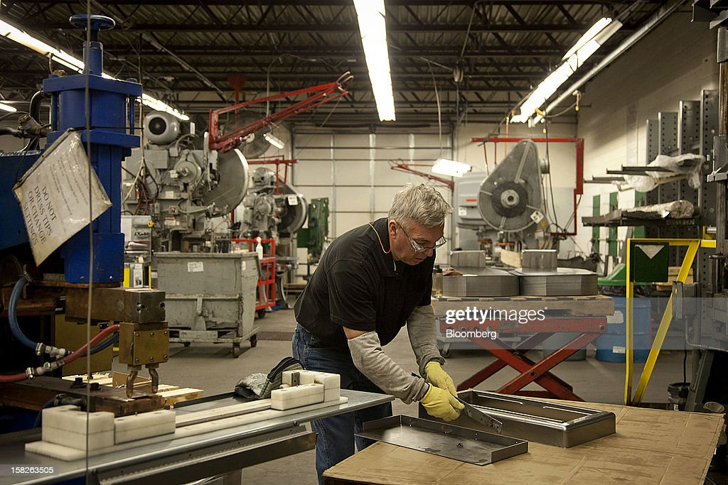 Machine operator Feriz Palic tests a product after setting up the line at the E.J. Ajax & Sons metalforming company in Minneapolis, Minnesota, U.S., on Thursday, Dec. 6, 2012. The U.S. Federal Reserve is scheduled to release industrial production data on Dec. 14. Photographer: Ariana Lindquist/Bloomberg via Getty Images