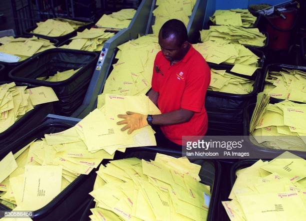 Machine Operator Ugo Benjamin Onyebalu sorts envelopes at the South London Mail Centre as a mountain of returned Census forms await processing 45...