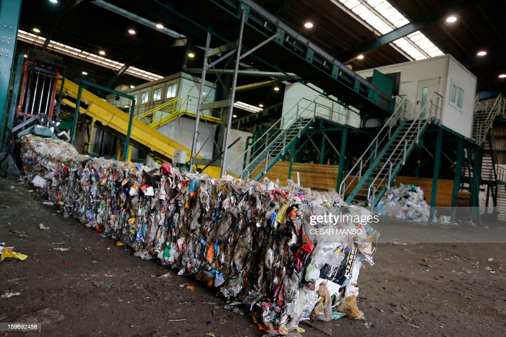 A machine packs garbage for recycling at a waste treatment plant in Burgos on January 18, 2013. AFP PHOTO/ CESAR MANSO