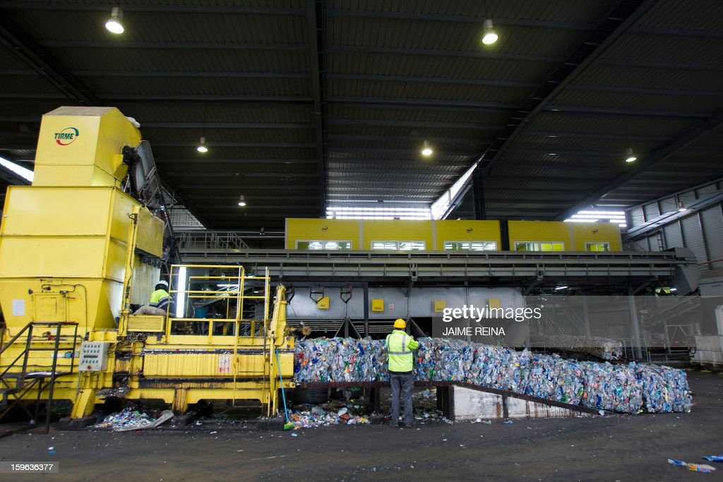 A machine packs plastics for recycling at a waste treatment plant in Palma de Mallorca on January 17, 2013. AFP PHOTO / Jaime REINA