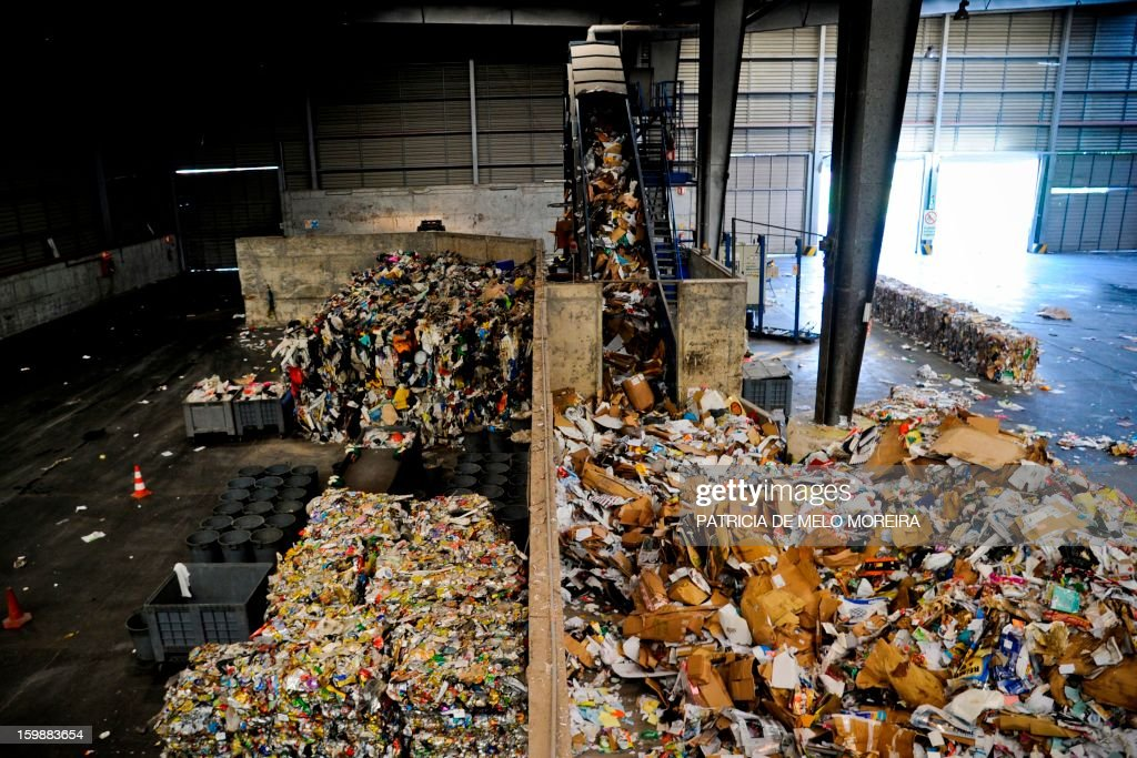A machine separate different types of waste for recycling at Valorsul, a waste treatment plant, in Lisbon on January 22, 2013. AFP PHOTO/PATRICIA DE MELO MOREIRA