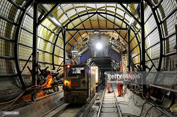 A machine spreads concrete in the Gotthard railway tunnel in Erstfeld Switzerland on Wednesday Oct 27 2010 When completed the tunnel will be the...