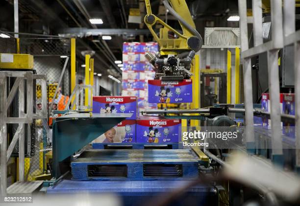A machine stacks boxes of Huggies brand diapers at the KimberlyClark Corp manufacturing facility in Paris Texas US on Tuesday Oct 27 2015...