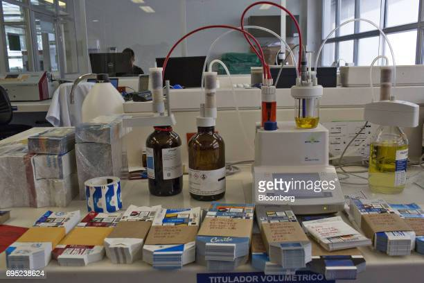 A machine used to check the quality of tobacco sits on a table in the lab area of the Philip Morris International Coltabaco SAS production facility...