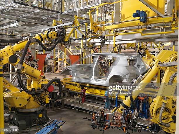 Machine Working On Car In Plant