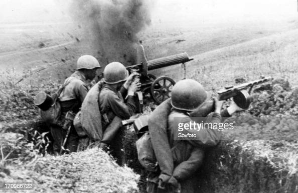 Machinegunners firing at the germans during battle for a height in the northern caucasus during world war ll 1942