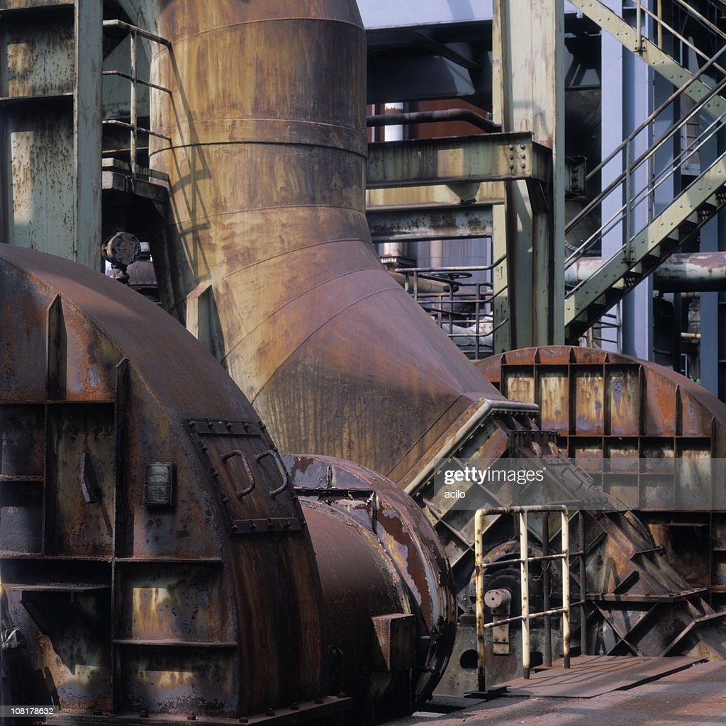 Machinery in a Rusted, Old Steel Mill : Stock Photo