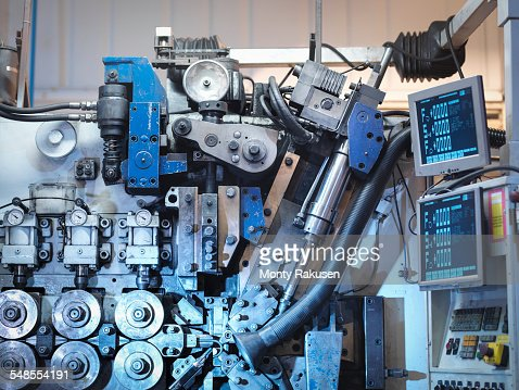 Machinery in automotive parts factory, detail