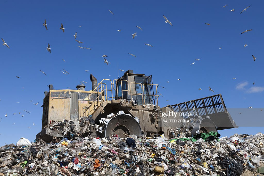 Machinery working on waste in landfill