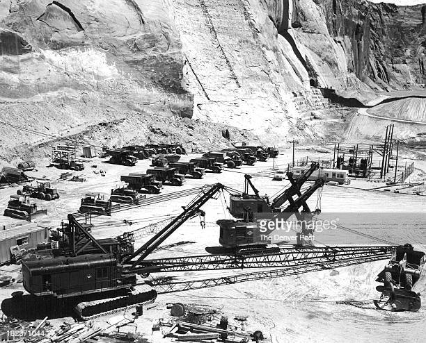 JUL 14 1959 Machines Idle at Glen Canyon Dam Site Trucks tractors draglines and other machinery stood idle Tuesday at the Glen Canyon dam site near...
