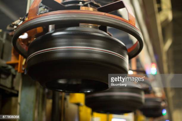 Machines move 'green' automobile tires before vulcanization at the Continental AG tire plant in Kaluga Russia on Wednesday Nov 22 2017 The strong...