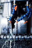 CNC machining station at work. Milling, threading, drilling. Industry, industrial concept.