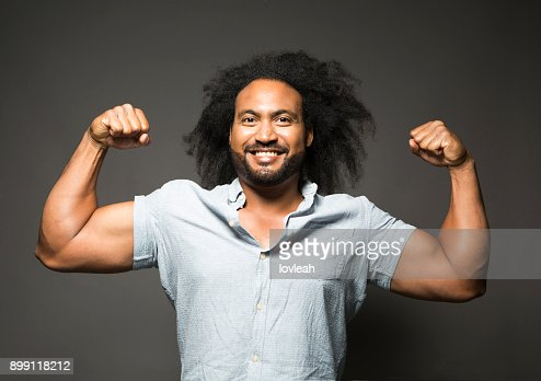 Macho man flexes biceps muscles : Stock Photo