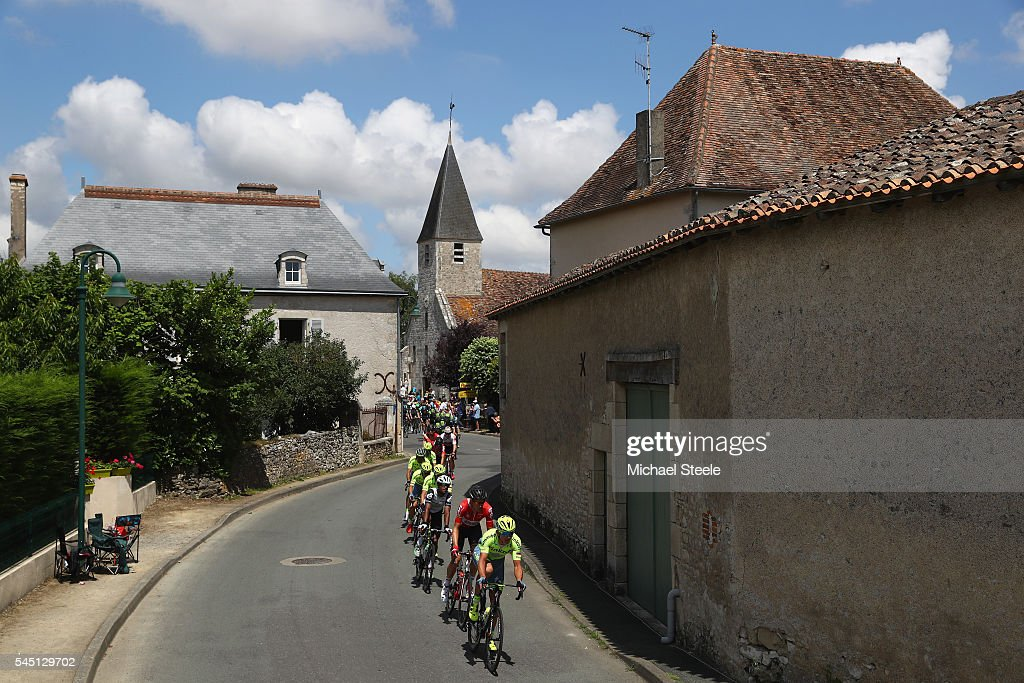 Maciej Bodnar of Poland and Tinkoff followed by Lars Bak of Denmark and Lotto Soudal lead the peloton through the village of La Cantiere during stage four of Le Tour de France from Saumar to Limoges on July 5, 2016 in Limoges, France.