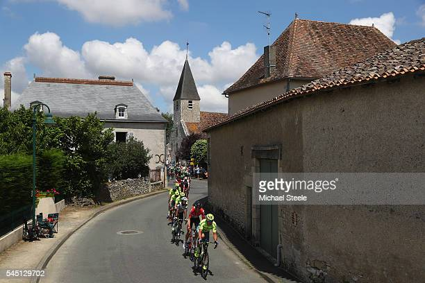 Maciej Bodnar of Poland and Tinkoff followed by Lars Bak of Denmark and Lotto Soudal lead the peloton through the village of La Cantiere during stage...