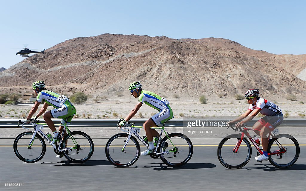 Maciej Bodnar of Poland leads team mate <a gi-track='captionPersonalityLinkClicked' href=/galleries/search?phrase=Peter+Sagan&family=editorial&specificpeople=4846179 ng-click='$event.stopPropagation()'>Peter Sagan</a> of Slovakia and Taiji Nishitani of Japan during stage two of the 2013 Tour of Oman from Fanja in Bidbid to Al Bustan on February 12, 2013 in Al Bustan, Oman.