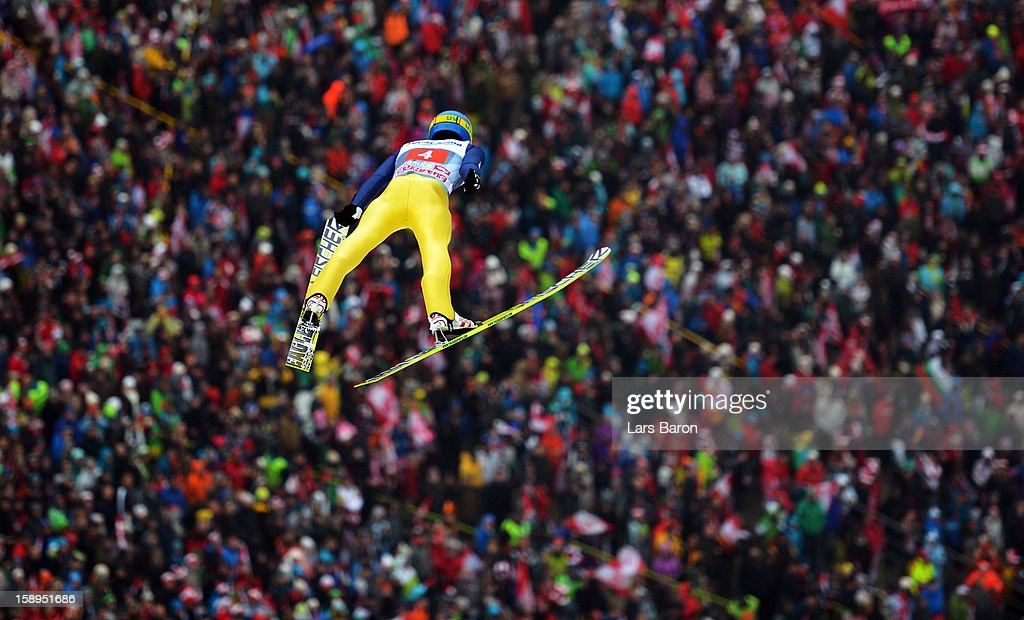 Maciej Kot of Poland competes during the first round for the FIS Ski Jumping World Cup event of the 61st Four Hills ski jumping tournament at Bergisel-Stadion on January 4, 2013 in Innsbruck, Austria.