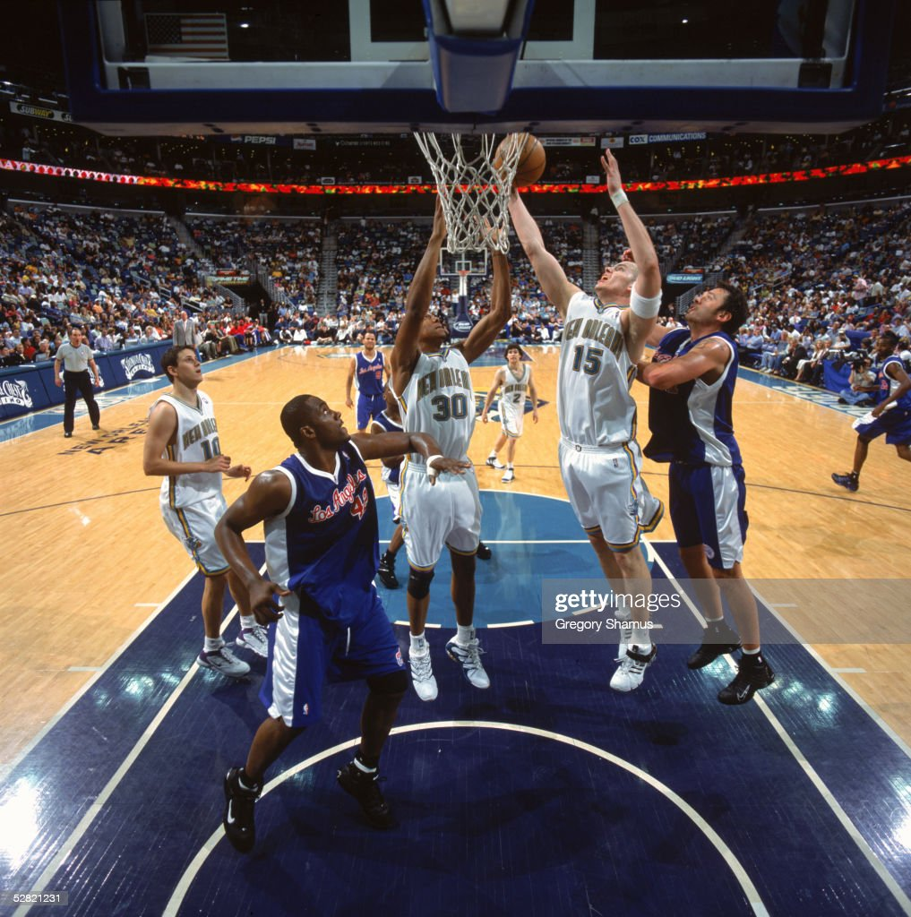 Maciej Lampe and David West of the New Orleans Hornets rebound against Elton Brand and Zeljko Rebraca of the Los Angeles Clippers during the game at...