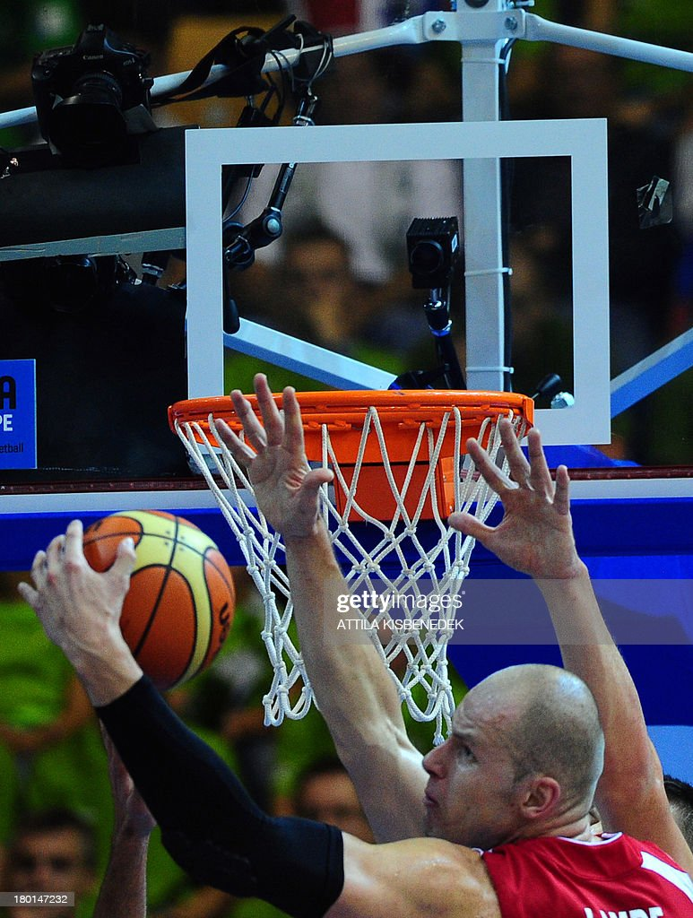Maciej Lampe of Poland fights for the ball during the group C qualification match to EuroBasket 2013 Championships between their teams in Celje on...