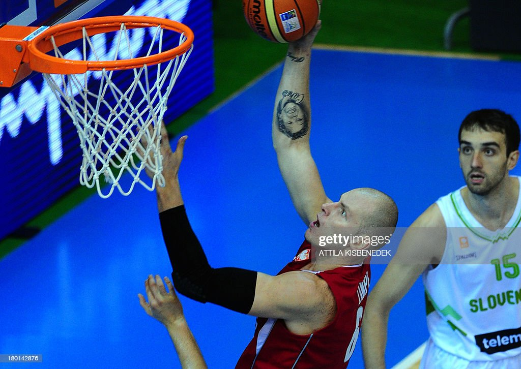 Maciej Lampe of Poland vies with Mirza Begic of Slovenia during the group C qualification match to EuroBasket 2013 Championships between their teams...