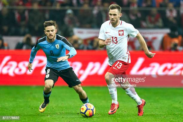 Maciej Rybus from Poland fights for the ball with Nahitan Nandez from Uruguay while Poland v Uruguay International Friendly soccer match at National...
