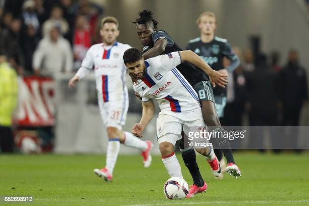 Maciej Rybus of Olympique Lyonnais Nabil Fekir of Olympique Lyonnais Bertrand Traore of Ajax Kasper Dolberg of Ajaxduring the UEFA Europa League semi...