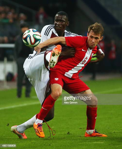 Maciej Rybus of Poland is challenged by Antonio Ruediger of Germany during the international friendly match between Germany and Poland at Imtech...