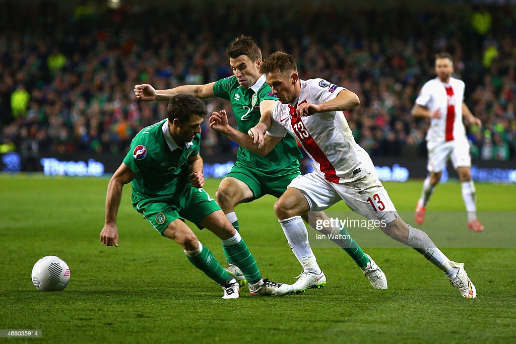 Maciej Rybus of Poland is challenged by Seamus Coleman and Wes Hoolahan of Republic of Ireland during the EURO 2016 Qualifier match between Republic...