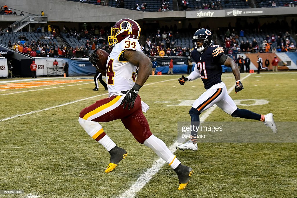 Mack Brown #34 of the Washington Redskins returns a 61 yd. touchdown in the fourth quarter past Tracy Porter #21 of the Chicago Bears at Soldier Field on December 24, 2016 in Chicago, Illinois. The Washington Redskins defeated the Chicago Bears 41-21.