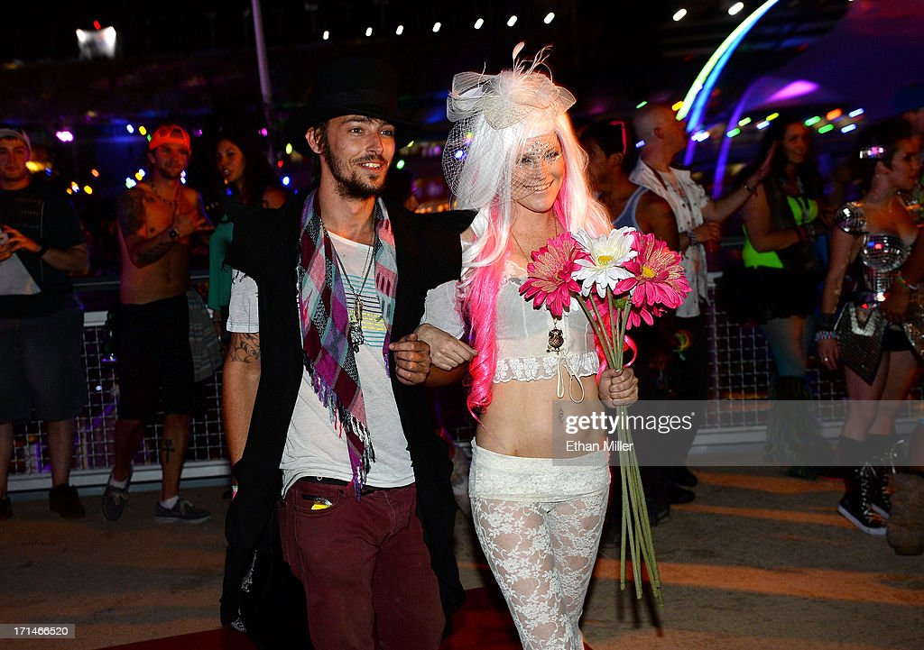 Mack Hedrick (L) walks Jessica O'Donnell down the aisle for her commitment ceremony at the 17th annual Electric Daisy Carnival at Las Vegas Motor Speedway on June 23, 2013 in Las Vegas, Nevada.
