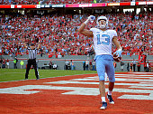 Mack Hollins of the North Carolina Tar Heels reacts after scoring a touhdown against the North Carolina State Wolfpack during their game at...