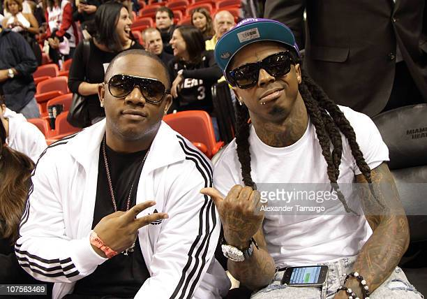 Mack Maine and Lil Wayne attend the Miami Heat vs New Orleans Hornets game at AmericanAirlines Arena on December 13 2010 in Miami Florida