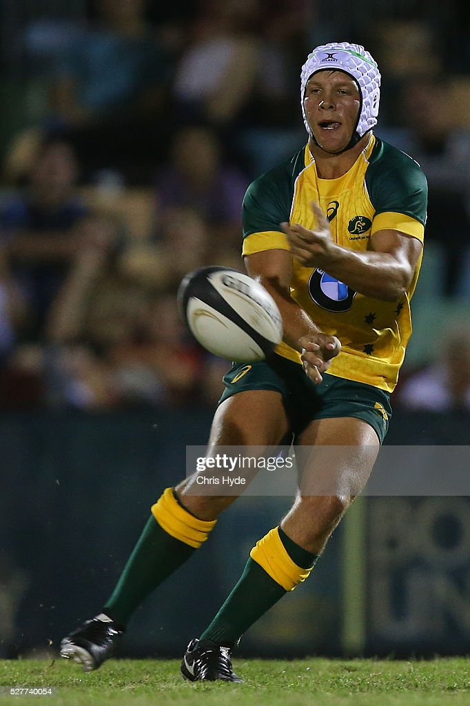 Mack Mason of Australia passes during the Under 20s Oceania Rugby match between Australia and New Zealand at Bond University on May 3, 2016 in Gold Coast, Australia.
