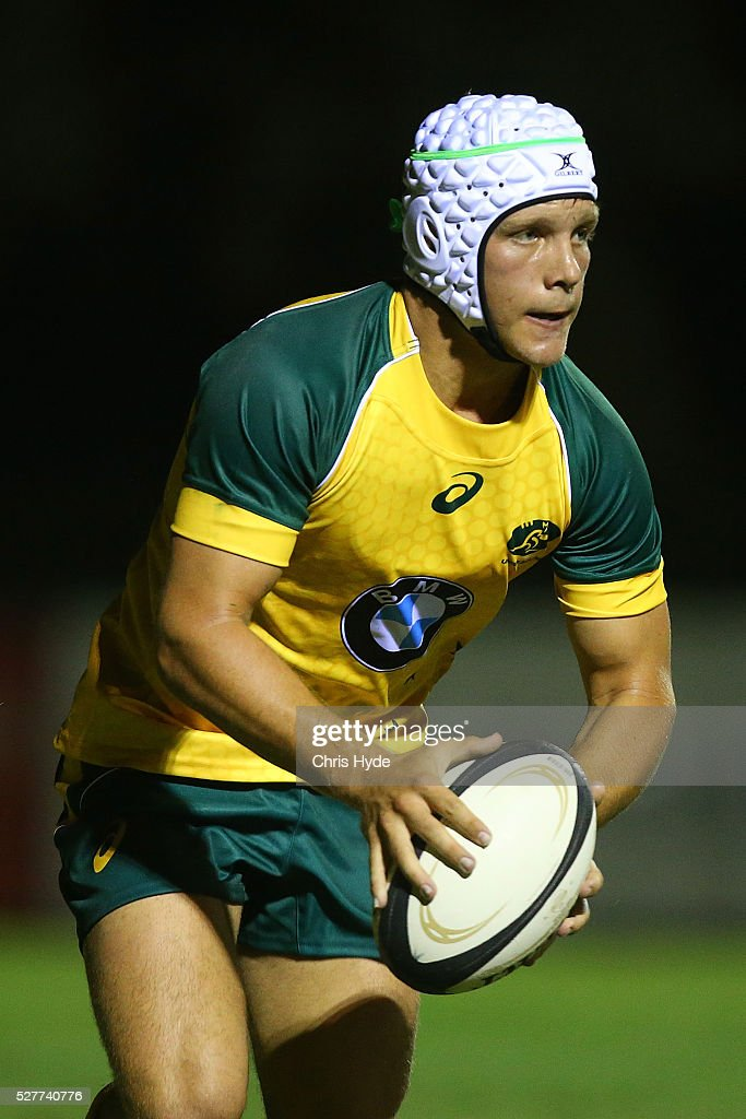 Mack Mason of Australia runs the ball during the Under 20s Oceania Rugby match between Australia and New Zealand at Bond University on May 3, 2016 in Gold Coast, Australia.