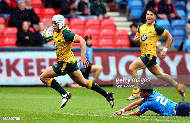 Mack Mason of Australia scores a try during the World Rugby U20 Championship match between Australia and Italy at AJ Bell Stadium on June 11 2016 in...