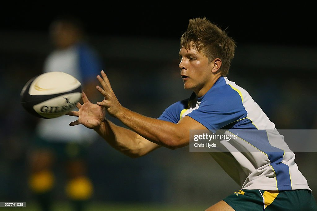 Mack Mason of Australia warms up before the Under 20s Oceania Rugby match between Australia and New Zealand at Bond University on May 3, 2016 in Gold Coast, Australia.