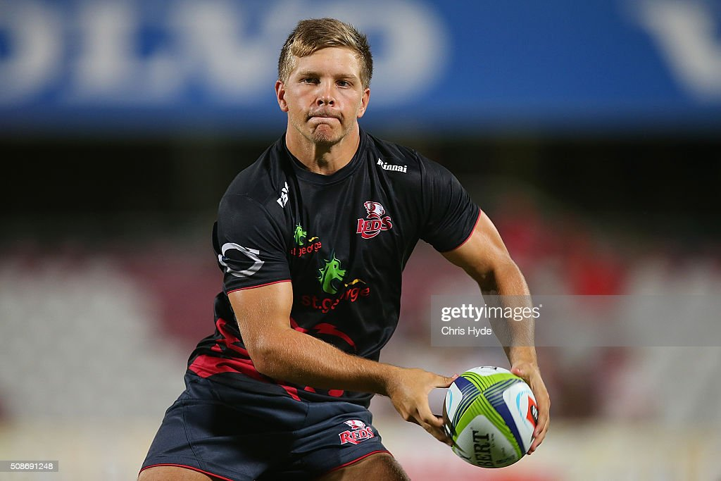 Mack Mason of the Reds passes before during the Super Rugby pre-season match between the Reds and the Crusaders at Ballymore Stadium on February 6, 2016 in Brisbane, Australia.