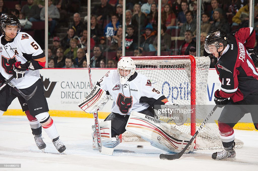 Mack Shields #31 of the Calgary Hitmen stops the shot of Cain Franson #12 of the Vancouver Giants in WHL action on October 20, 2012 at Pacific Coliseum in Vancouver, British Columbia, Canada.