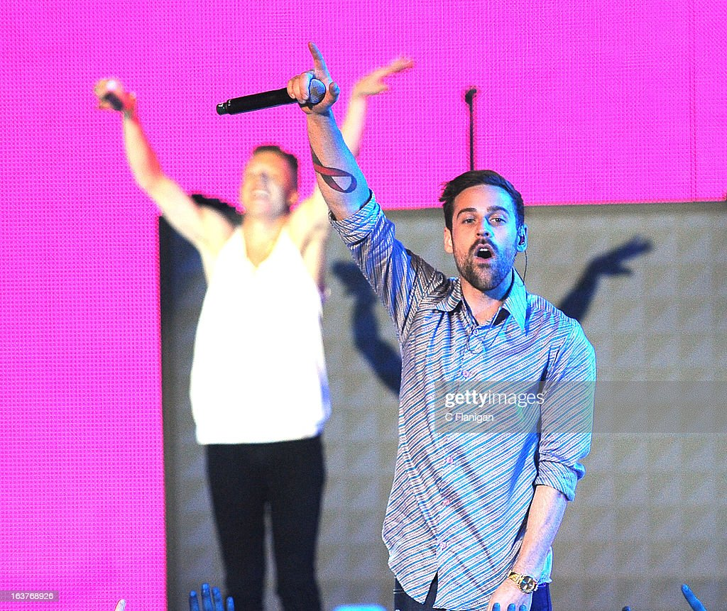 Mackelmore and Ryan Lewis perform during the 2013 mtvU Woodie Awards on March 14, 2013 in Austin, Texas.