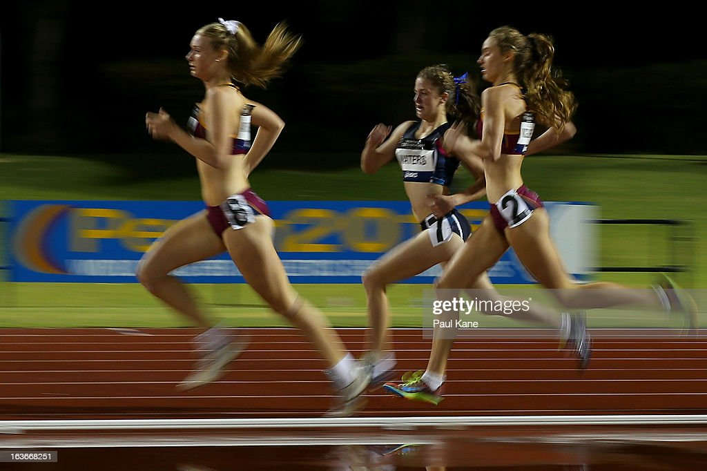 Mackenzie Andrews of Queensland, Rachel Waters of Victoria and Madeline McGuire of Queensland compete in the women's u17 800 metre final during day three of the Australian Junior Championships at the WA Athletics Stadium on March 14, 2013 in Perth, Australia.