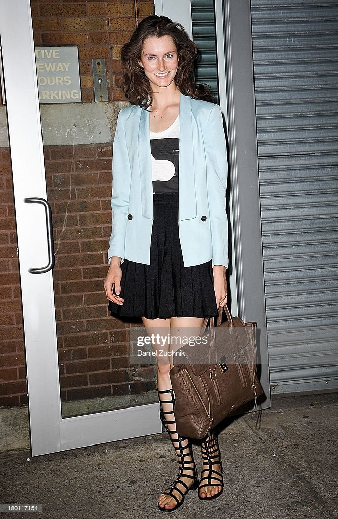 Mackenzie Drazan is seen outside the Zac Posen show wearing a Zac Posen skirt, Rag and Bone top, Zara sweater and Stuart Weitzman shoes on September 8, 2013 in New York City.
