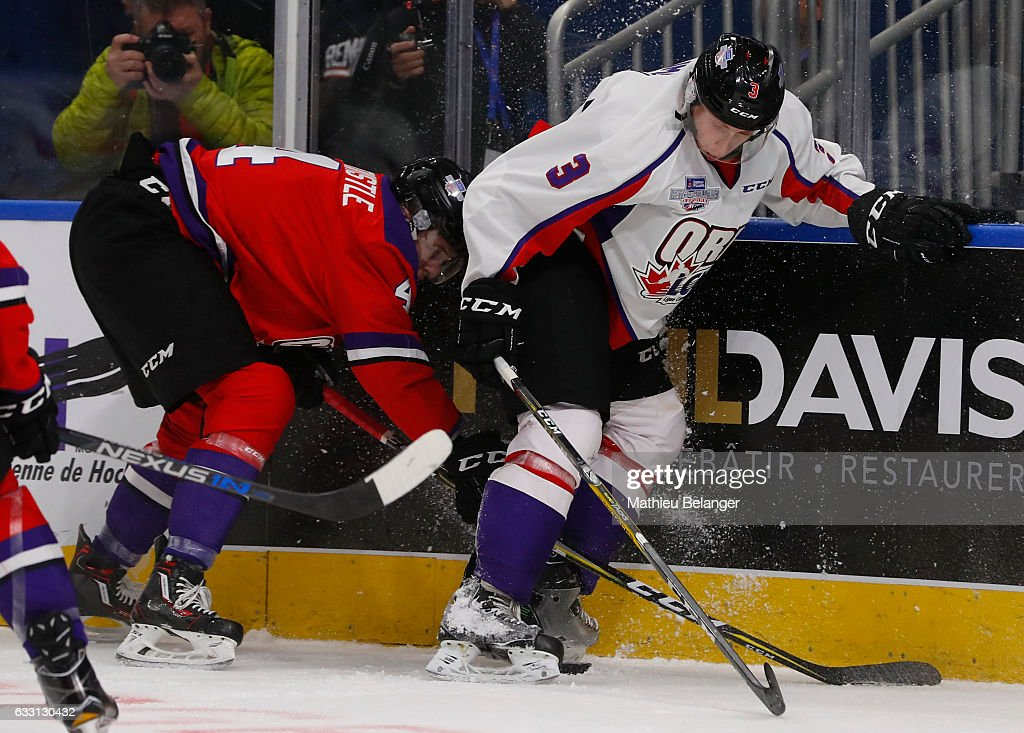 MacKenzie Entwistle #4 of Team Cherry and Juuso Valimaki #3 of Team Orr battle for the puck during the third period of their Sherwin-Williams CHL/NHL Top Prospects Game at the Videotron Center on January 30, 2017 in Quebec City, Quebec, Canada.