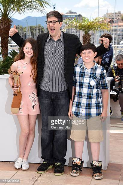 Mackenzie Foy director Mark Osborne and Riley Osborne attend a photocall for 'The Little Prince' during the 68th annual Cannes Film Festival on May...