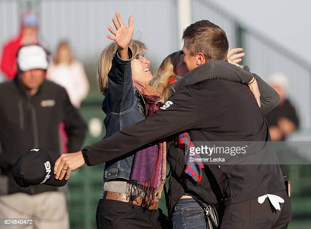 Mackenzie Hughes of Canada celebrates with his mother Sandra and wife Jenna after winning the playoff in the final round of the RSM Classic at Sea...