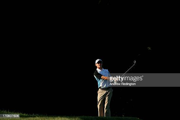 Mackenzie Hughes of Canada hits his second shot on the tenth hole during the continuation of Round Two of the 113th US Open at Merion Golf Club on...