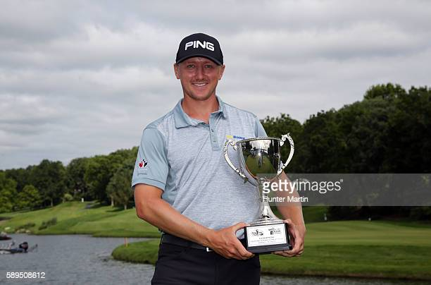 Mackenzie Hughes of Canada holds the championship trophy after winning the Webcom Tour Price Cutter Charity Championship presented by Dr Pepper at...