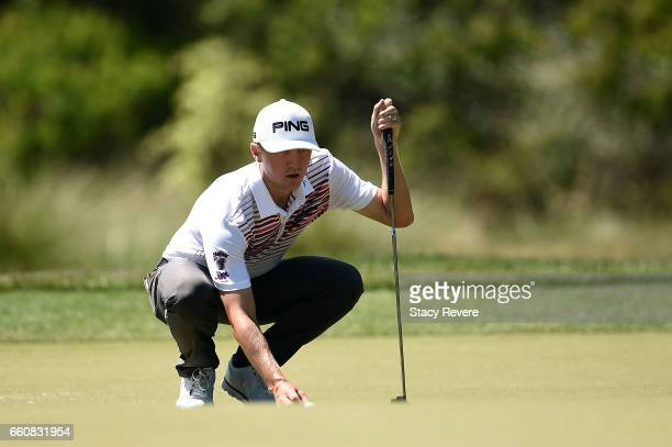 Mackenzie Hughes of Canada lines up a putt on the fifth green during the first round of the Shell Houston Open at the Golf Club of Houston on March...